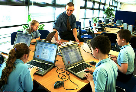 A group of students using technology